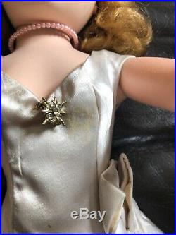 1956 Madame Alexander blonde Cissy doll in TLC Side Draped Satin Gown, flowers