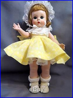 Alexander-kins tagged 1953 in rare yellow star dress, lovely
